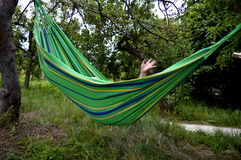 Hammock. Enjoy summer holidays on hammock, holiday greetings Royalty Free Stock Photos
