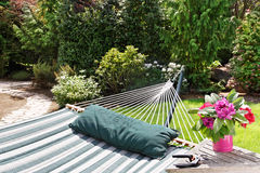 Hammock in garden. Relax and enjoy the garden after cutting some flowers Royalty Free Stock Photography
