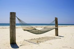 Hammock Grand Bahama Island. A hammock sits quietly in the tropical breeze in Bishop's Point, Grand Bahama Island Royalty Free Stock Image