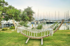 Hammock on grass in a resort against marine, Concept vacation relax.  Royalty Free Stock Image