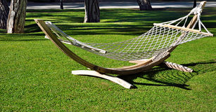 Hammock on a green lawn Stock Photography