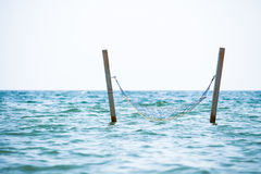 Hammock hanged in see water Stock Images