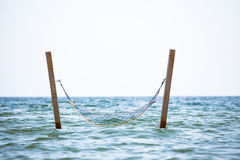 Hammock hanged in see water Stock Photo