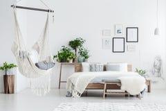 Hammock hanging in bedroom royalty free stock photos