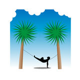 Hammock Heaven. Figure resting on a hammock in beautiful surroundings Royalty Free Stock Image