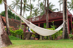 Hammock hung on palm trees for relax vacation Royalty Free Stock Photos