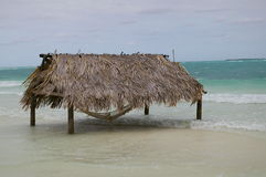 Hammock Hut. Thatched Roof Hammock Hut in Ocean Royalty Free Stock Images