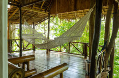 Hammock inside a wodden bungalow in the jungle Royalty Free Stock Photos