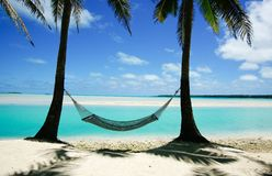 Hammock by lagoon. Royalty Free Stock Photo