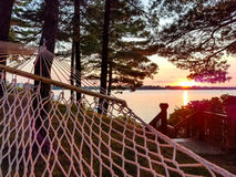 Hammock by the Lake with Summer Sunet Landscape Stock Photo