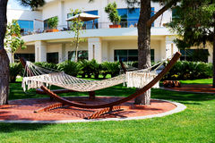 The hammock is on lawn in luxury hotel Royalty Free Stock Images