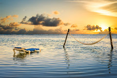 Hammock and Lounge Chair in the Ocean Royalty Free Stock Images