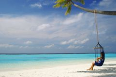Hammock maldives. Woman relaxing in Hammock in Maldives royalty free stock photos