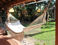 Hammock in Manzanillo. White hammock in a patio garden Stock Photography