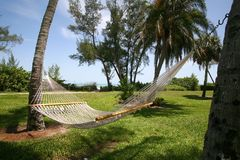 Hammock with Ocean View. A photo taken of a hammock between two palm trees with the ocean in the background. Photo taken on Sanibel / Captiva Island royalty free stock image