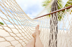 Free Hammock On Tropical Beach With Palm Leaf Thatch Roofing Umbrellas And Palm Trees In The Background Stock Photos - 89011003