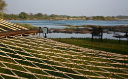 Hammock overlooking the river. On the Zambezi River in South Africa directly from a view of the Victoria Falls, the hotel is located. In the courtyard of the Royalty Free Stock Photos