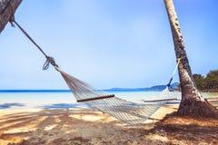 Hammock on paradise beach, holidays. On tropical island Stock Photo