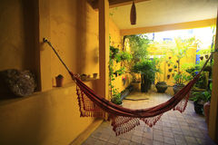 Hammock in patio Stock Images