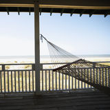 Hammock on porch. View of beach from porch with railing and hammock at Bald Head Island, North Carolina Stock Photos