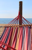 Hammock for relaxing on the beach by the sea at the resort Royalty Free Stock Photo