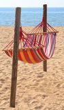 Hammock for relaxing on the beach by the sea at the resort Stock Images