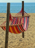 Hammock for relaxing on the beach by the sea at the resort Stock Photography