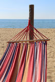 Hammock for relaxing on the beach by the sea Stock Photo