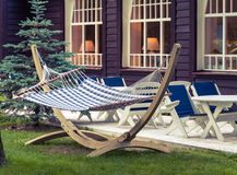 Hammock in resort. Relaxation zone - hammock in the backyard of the beach hotel in the evening stock photos