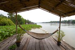 Hammock beside river Royalty Free Stock Photography