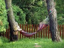 Hammock. Rnhammock, hammock in a tree in a garden hammock, hammock in the trees, resting on a hammock, relax royalty free stock photos