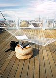Hammock on roof with dog and books Stock Images