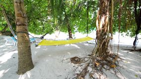 Hammock, sand beach and ocean wave, South Male Atoll stock video footage