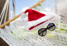 Hammock with santa helper hat and shades Stock Photo