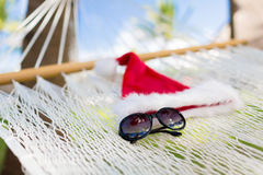 Hammock with santa helper hat and shades Stock Images