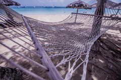 Hammock in the shade of the Caribbean royalty free stock photography