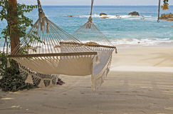 Hammock in the shade by the ocean Stock Images