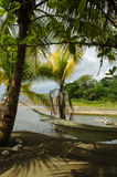 A hammock in the shadow of the palm tree. On the tropical beach - Carate, Costa Rica Stock Photography