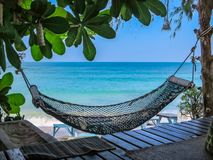Hammock at a shady place in paradise royalty free stock images