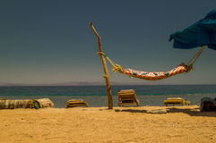 Hammock on the shore of the Red Sea Stock Photo