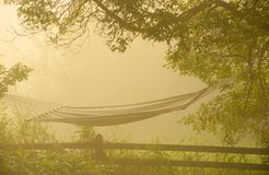 Hammock at sunrise in fog. Royalty Free Stock Photography