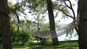 Hammock swing with a sea view stock video