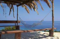 Hammock Swing on a tropical beach - vacation Stock Photo