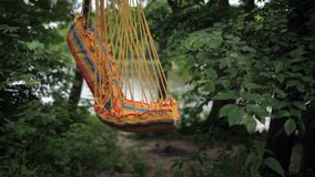 Hammock swings. Empty swing hammock swinging in the wind stock footage