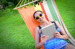 In Hammock With Tablet PC Royalty Free Stock Image