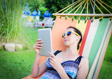 In Hammock With Tablet PC Stock Image