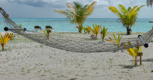 Hammock for take nap with beach views. Royalty Free Stock Photo
