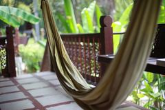 Hammock on the terrace of a villa in the jungle Stock Images
