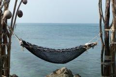 Hammock tied rocks overlooking the sea. stock images