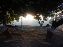 A hammock tied with two trees. royalty free stock image